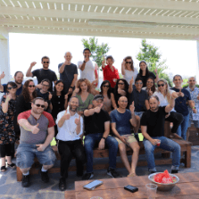 The whole Penguin Strategies Company on rooftop party